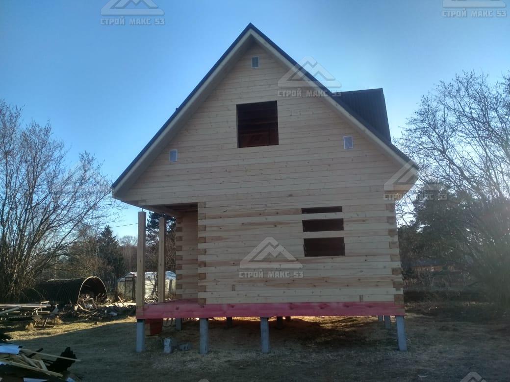брусовой дом на свайном фундаменте