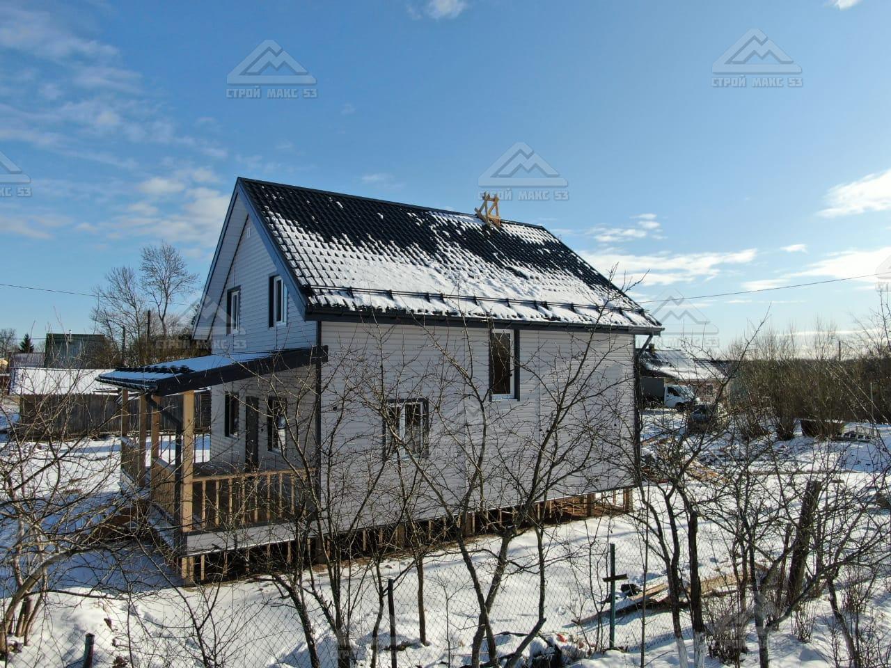 каркасный дом с террасой вид сбоку